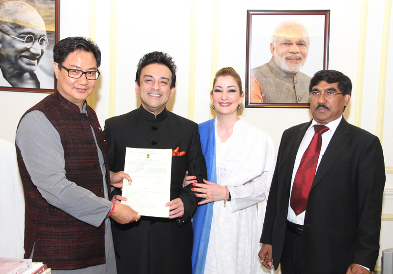 The Minister of State for Home Affairs, Mr. Kiren Rijiju presenting the Certificate of Indian Citizenship by Naturalization to noted singer and musician Mr. Adnan Sami, in New Delhi on January 01, 2016. The Additional Secretary (Foreigners), MHA, Mr. B.K. Prasad and Ms. Adnan Sami are also seen.