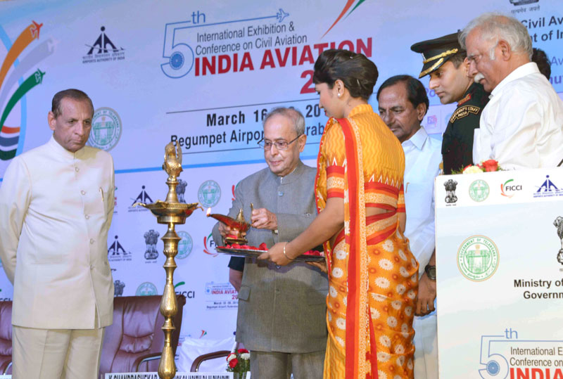 The President, Mr. Pranab Mukherjee lighting the lamp to inaugurate the 5th Edition of Binennial Aviation Event on the theme 'India's Civil Aviation Sector: Potential a Global Manufacturing & MRO Hub', at Hyderabad on March 16, 2016. The Governor of Andhra Pradesh and Telangana, Mr. E.S.L. Narasimhan the Union Minister for Civil Aviation, Mr. Ashok Gajapathi Raju Pusapati and the Chief Minister of Telangana, Mr. K. Chandrashekar Rao are also seen.