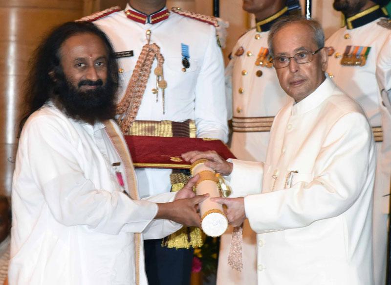 The President, Mr. Pranab Mukherjee presenting the Padma Vibhushan Award to Sri Sri Ravi Shankar, at a Civil Investiture Ceremony, at Rashtrapati Bhavan, in New Delhi on March 28, 2016.
