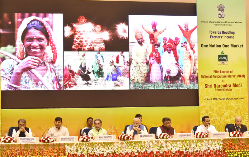 The Prime Minister, Mr. Narendra Modi at the launching ceremony of e-NAM - the e-trading platform for the National Agriculture Market, in New Delhi on April 14, 2016. The Union Minister for Agriculture and Farmers Welfare, Mr. Radha Mohan Singh, Union Minister for Communications & Information Technology, Mr. Ravi Shankar Prasad, the Ministers of State for Agriculture and Farmers Welfare, Dr. Sanjeev Kumar Balyan and Mr. Mohanbhai Kalyanjibhai Kundariya and other dignitaries are also seen.