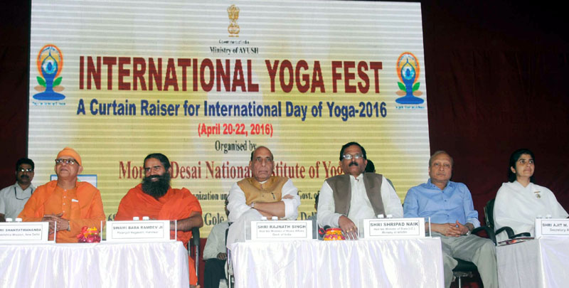The Union Home Minister, Mr. Rajnath Singh and the Minister of State for AYUSH (Independent Charge) and Health & Family Welfare, Mr. Shripad Yesso Naik, at the valedictory function of the International Yoga Fest, organised by the Ministry of AYUSH, in New Delhi on April 22, 2016. Swami Baba Ramdev and other dignitaries are also seen.