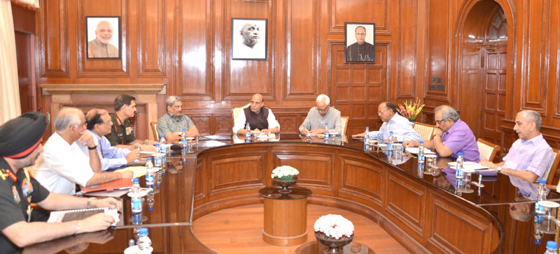 The Union Home Minister, Mr. Rajnath Singh chairing a high level meeting to review the developmental projects of Jammu & Kashmir, in New Delhi on May 05, 2016. The Union Minister for Defence, Mr. Manohar Parrikar, the Governor of Jammu & Kashmir Mr. N.N. Vohra, the National Security Advisor, Mr. Ajit Doval and other senior officers of Ministry of Home Affairs and Ministry of Defence are also seen.