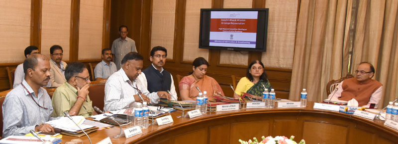The Union Minister for Finance, Corporate Affairs and Information & Broadcasting, Mr. Arun Jaitley chairing the meeting of High Powered Committee on Swachh Bharat Mission and Ganga Rejuvenation, in New Delhi on June 22, 2016. The Union Minister for Women and Child Development, Mrs. Maneka Sanjay Gandhi, the Union Minister for Human Resource Development, Mrs. Smriti Irani, the Minister of State for Information & Broadcasting, Col. Rajyavardhan Singh Rathore and other dignitaries are also seen.