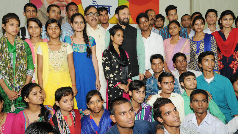The Union Minister for Human Resource Development, Mr. Prakash Javadekar in a group photograph with the students, who cleared XII with high marks and got admission to reputed colleges, at a function, in New Delhi on July 17, 2016. The Secretary, School Education and Literacy, Dr. Subash Chandra Khuntia is also seen.
