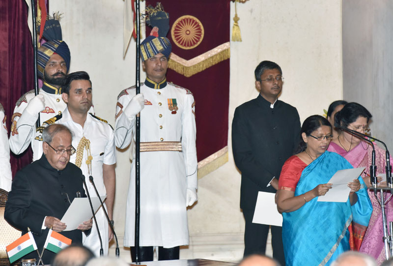 The President, Mr. Pranab Mukherjee administering the oath as Minister of State to Mrs. Krishna Raj, at a Swearing-in Ceremony, at Rashtrapati Bhavan, in New Delhi on July 05, 2016.