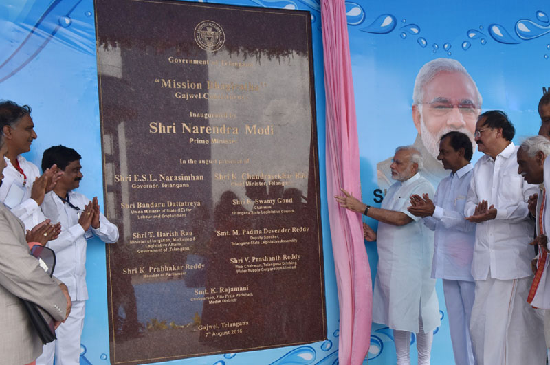 The Prime Minister, Mr. Narendra Modi unveils Plaque for Launch of the Mission Bhagiratha, in Telangana on August 07, 2016. The Union Minister for Urban Development, Housing & Urban Poverty Alleviation and Information & Broadcasting, Mr. M. Venkaiah Naidu, the Chief Minister of Telangana, Mr. K. Chandrasekhar Rao and the Minister of State for Labour and Employment (Independent Charge), Mr. Bandaru Dattatreya are also seen.
