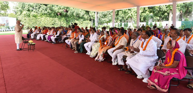 The Prime Minister, Mr. Narendra Modi interacting with the Village Pradhans from Varanasi Parliamentary Constituency, in New Delhi on August 08, 2016.