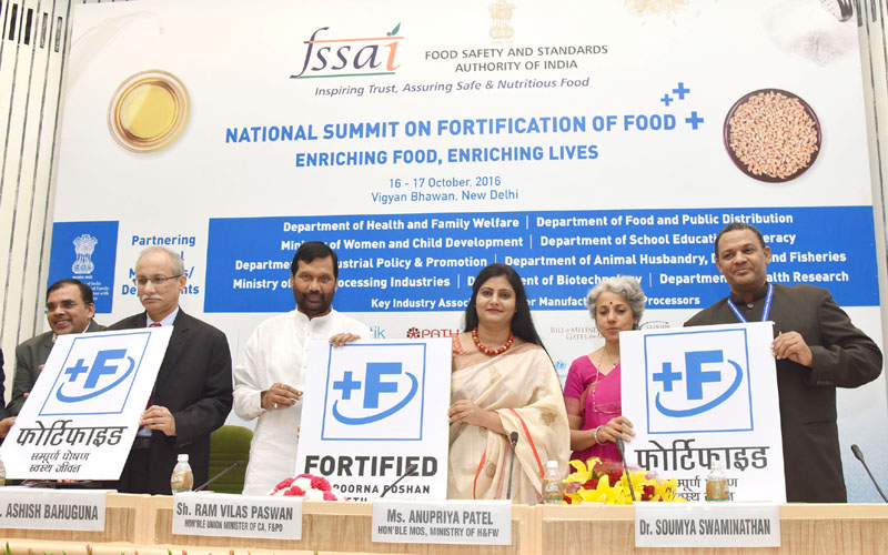 The Union Minister for Consumer Affairs, Food and Public Distribution, Mr. Ram Vilas Paswan and the Minister of State for Health & Family Welfare, Mrs. Anupriya Patel launching the food fortification logo, at the inauguration of the two-day National Summit on Fortification of Food, organised by the FSSAI, in New Delhi on October 16, 2016. The Secretary, Directorate of Health Research & Director General, Indian Council of Medical Research, Dr. Soumya Swaminathan and other dignitaries are also seen.