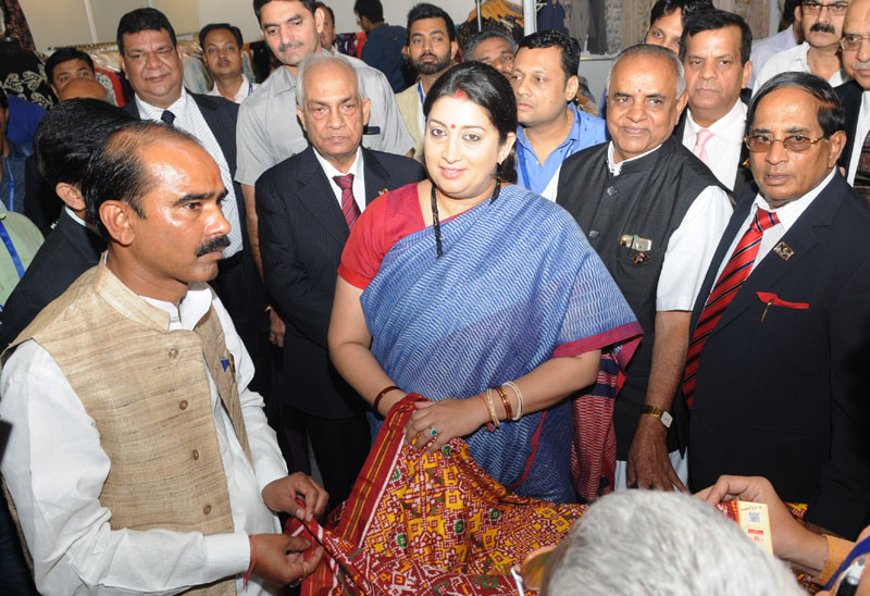 The Union Minister for Textiles, Mrs. Smriti Irani visiting after inaugurating the 5th edition of India International Silk Fair, in New Delhi on October 15, 2016. The Minister of State for Textiles, Mr. Ajay Tamta and other dignitaries also seen.