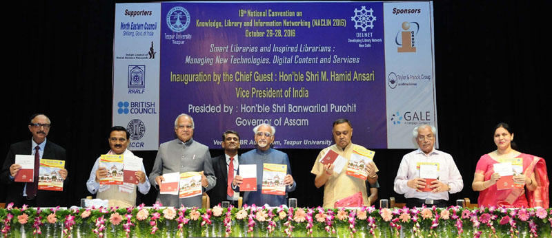 The Vice President, Mr. M. Hamid Ansari releasing the publications, at the 19th National Convention on Knowledge, Library and Information Networking - NACLIN 2016, at Tezpur University, in Assam on October 26, 2016. The Governor of Assam, Mr. Banwarilal Purohit and the Minister for Irrigation, Handloom & Textiles, Assam, Mr. Ranjit Dutta are also seen.
